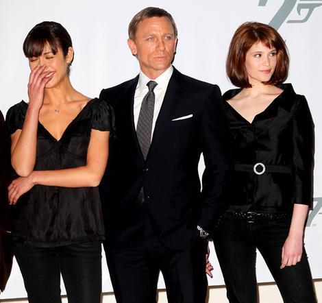 Bond girl Olga Kurylenko (left) with Daniel Craig (James Bond) and British actress Gemma Arterton.